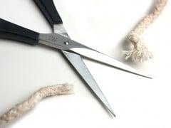 Scissors cutting a rope
