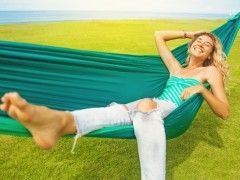 carefree woman relaxing in a hammock