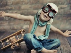 Child_Boy_Helmet_Goggles_Jeans_Airplane_Toy_Mood_2026473468